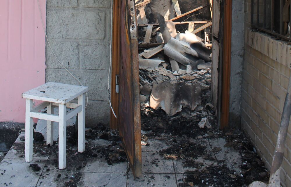 Casa destruída em Donetsk.