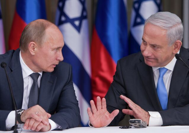 Russian President Vladimir Putin, left, listens to his host Israeli Prime Minister Benjamin Netanyahu as they prepare to deliver joint statements after their meeting and a lunch in the Israeli leader's Jerusalem residence, Monday, June 25, 2012