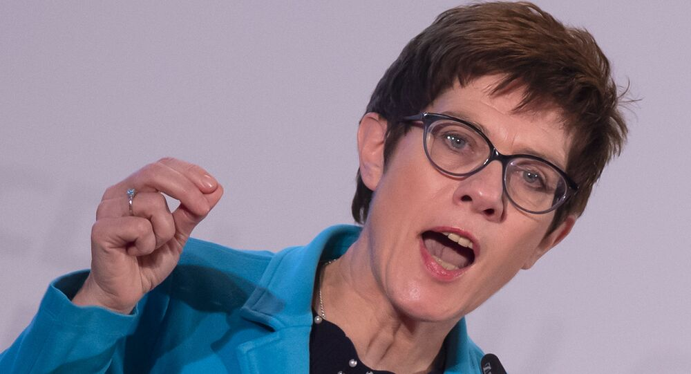 Annegret Kramp-Karrenbauer, General Secretary of the German Christian Democratic Union, gestures during her speech at the CDU regional conference to present her concept as candidate for the CDU chairmanship in Seebach, central Germany, Wednesday, Nov. 21, 2018