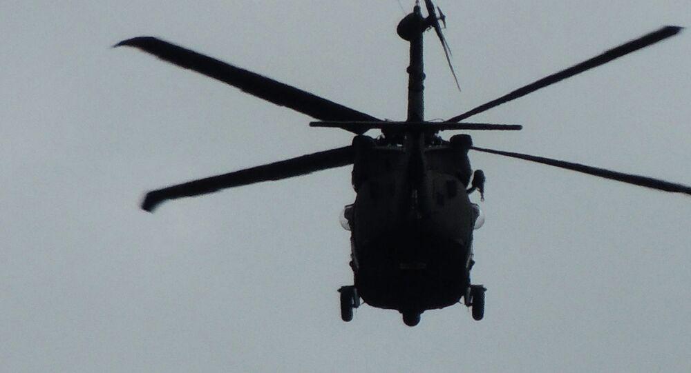 Helicóptero em missão