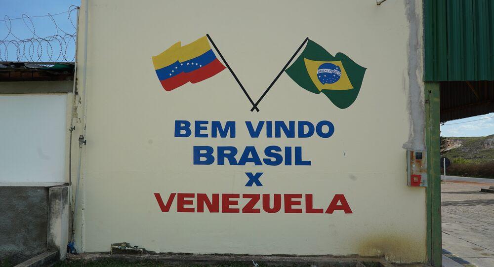 Parede pintada na cidade brasileira de Pacaraima, em Roraima, perto da fronteira com a Venezuela