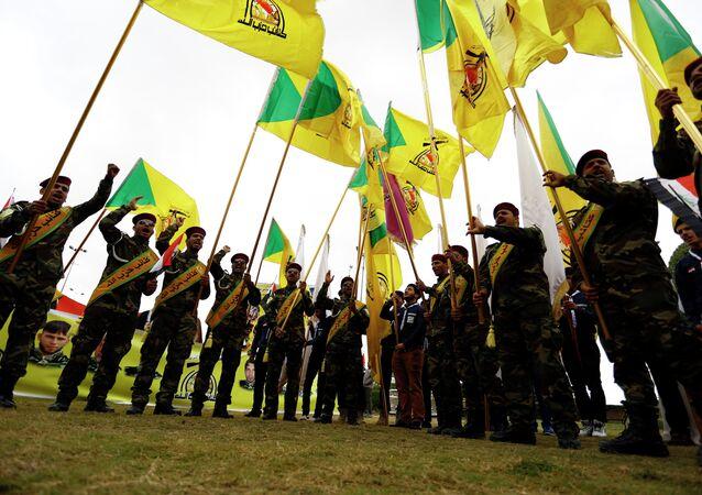 Membros da Brigada do Hezbollah no Iraque, onde o grupo libanês participa das operações para deter o avanço do Estado Islâmico