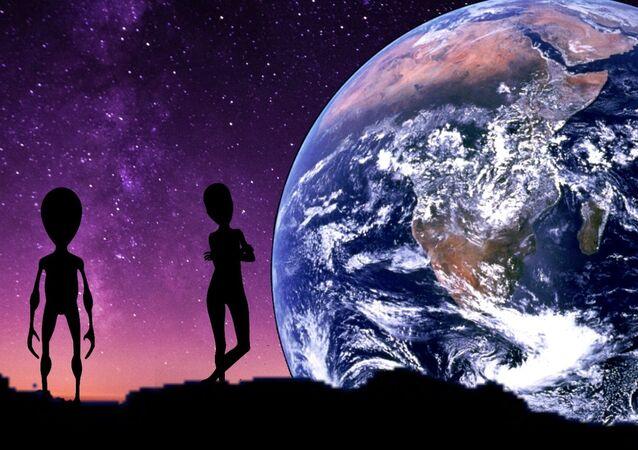 Extraterrestres com Terra em fundo (imagem referencial)