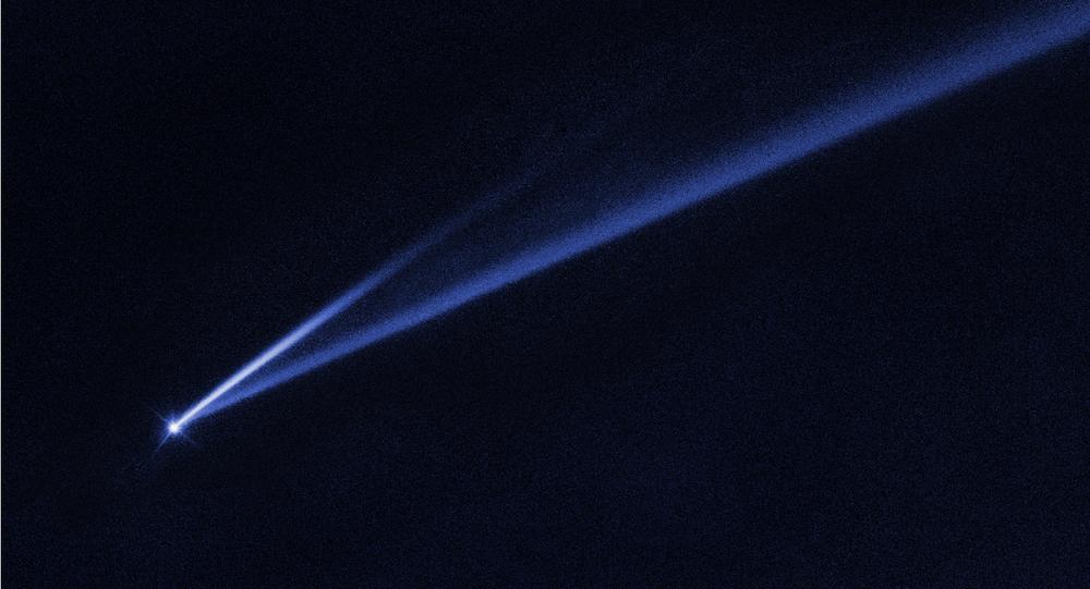 Asteroide Gault 6478 com cauda gravado pelo telescópio espacial Hubble