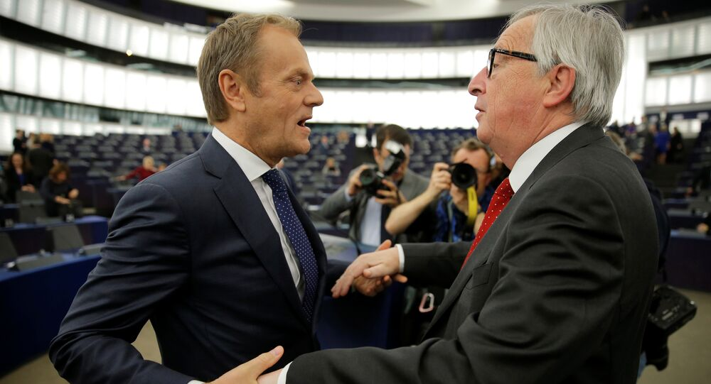 European Commission President Jean-Claude Juncker (R) talks with European Council President Donald Tusk ahead of a debate on the outcome of the latest European Summit on Brexit, at the European Parliament in Strasbourg, France, March 27, 2019
