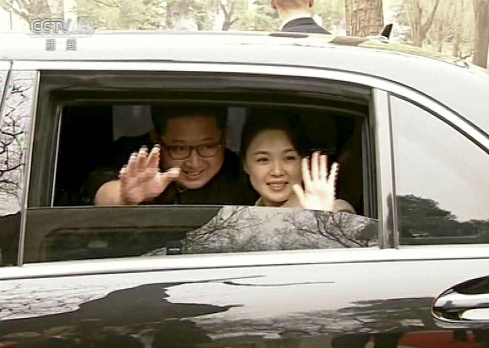 O Líder norte-coreano com esposa em Pequim