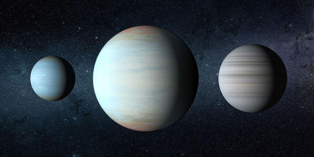Terceiro planeta, no centro da imagem, a ser descoberto no sistema estelar Kepler-47 (não entendi - linda)