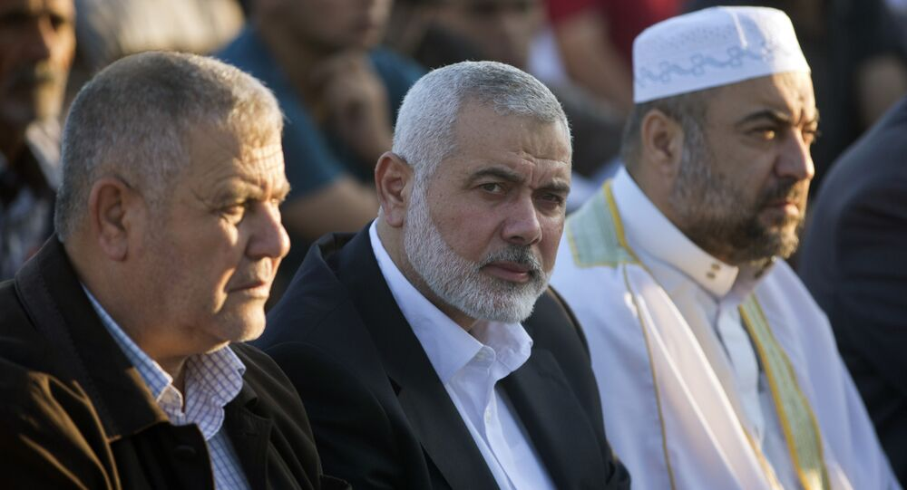 Palestinian Hamas top leader Ismail Haniyeh, center, attends the Eid al-Fitr prayers marking the end of the holy fasting month of Ramadan, in Eastern Gaza City, Friday, June 15, 2018