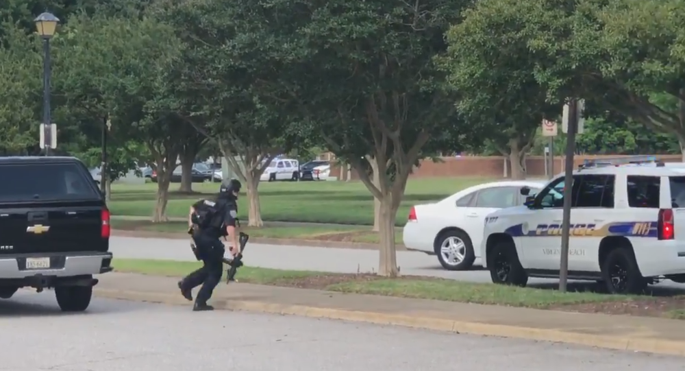 Police Officer responds to reports of a shooting in a Virginia Beach municipal center, May 31, 2019