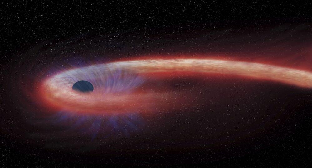 Representação artística fornecida pela NASA mostra estrela sendo engolida por buraco negro