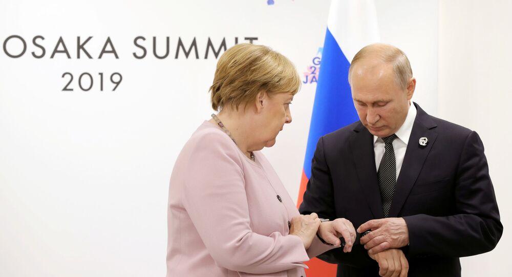 Encontro de  Vladimir Putin e Angela Merkel em 29 de junho, às margens da cúpula do G20 em Osaka, no Japão.
