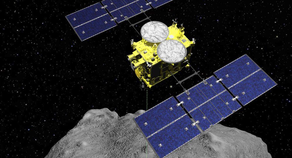 Imagem computadorizada da nave espacial Hayabusa 2 perto do asteroide Ryugu, em 5 de abril de 2019 (foto de arquivo)