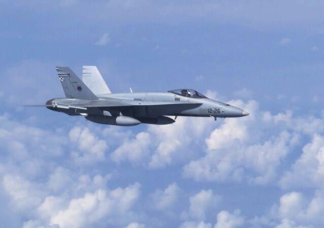 F-18 da OTAN tenta se aproximar do avião do ministro da Defesa russo