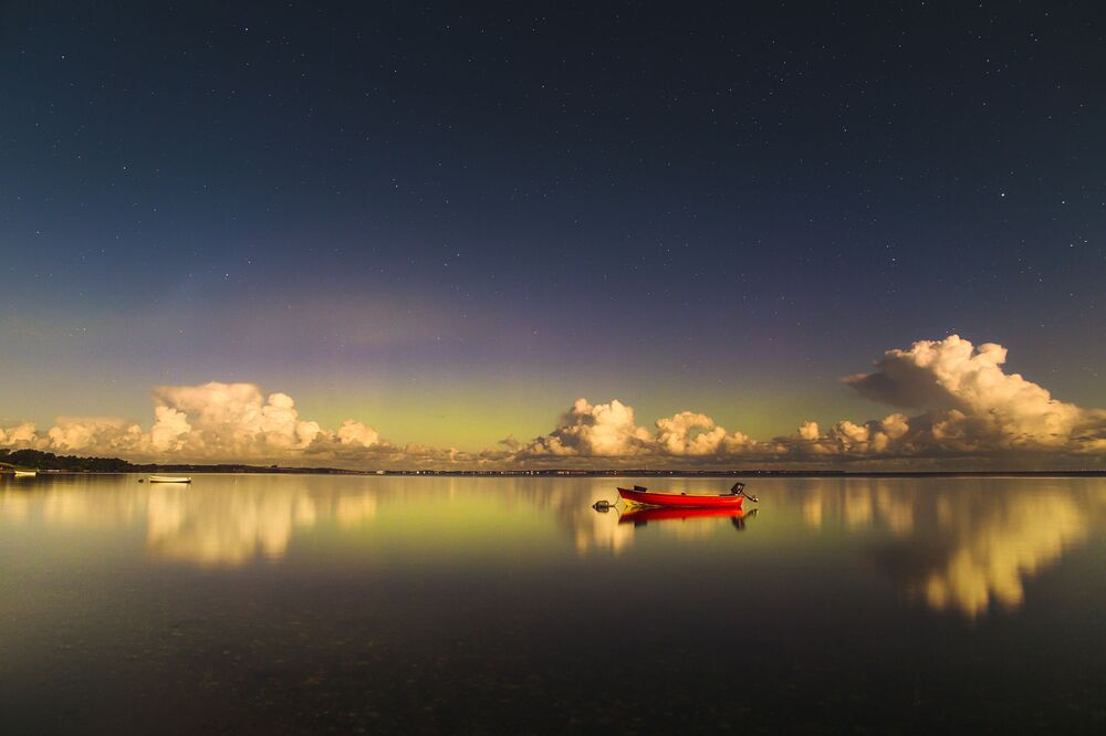 Imagem tirada pelo fotógrafo letão Ruslan Merzlyakov, altamente classificado na categoria Aurorae, da competição Insight Investment Astronomy Photographer of the Year 2019, exibe a aurora boreal na Dinamarca