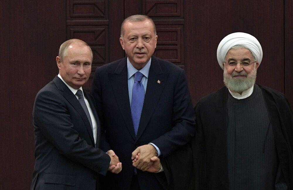 Presidentes da Rússia, da Turquia e do Irã (Vladimir Putin, Recep Tayyip Erdogan e Hassan Rouhani) em coletiva de imprensa conjunta na Turquia, 16 de setembro de 2019