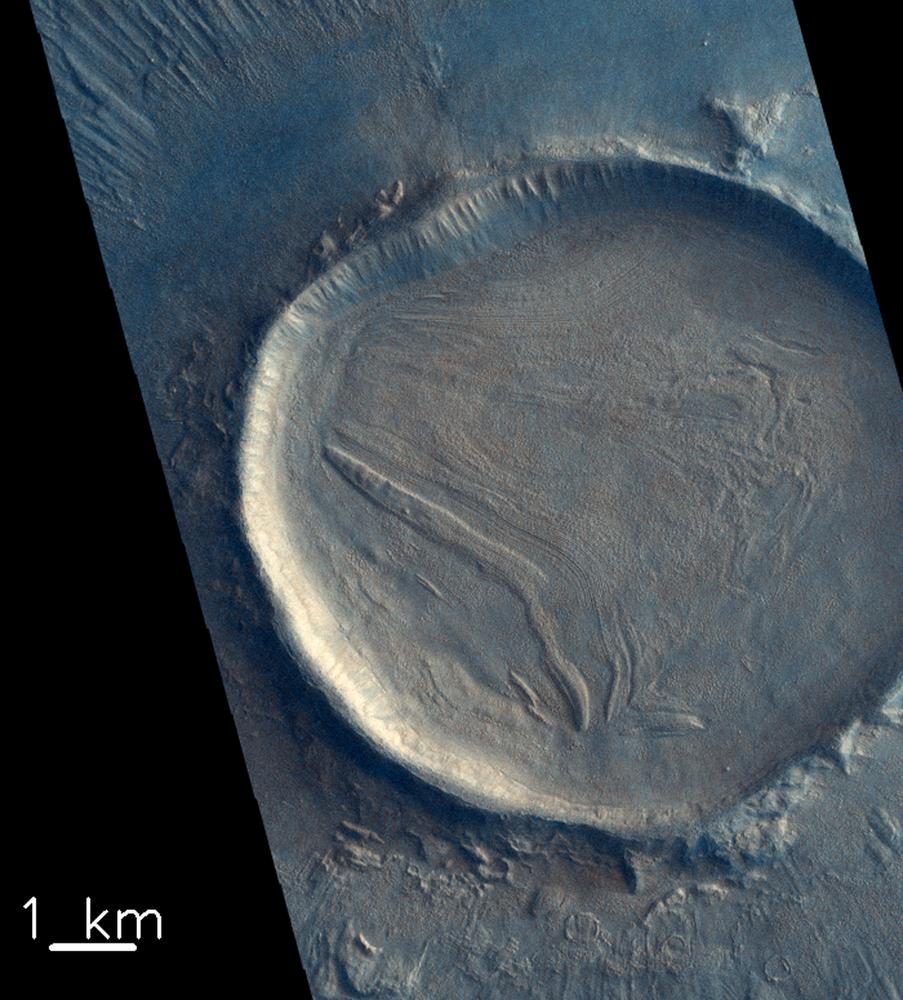 Cratera em Marte fotografada pelo módulo de investigação atmosférica Trace Gas Orbiter