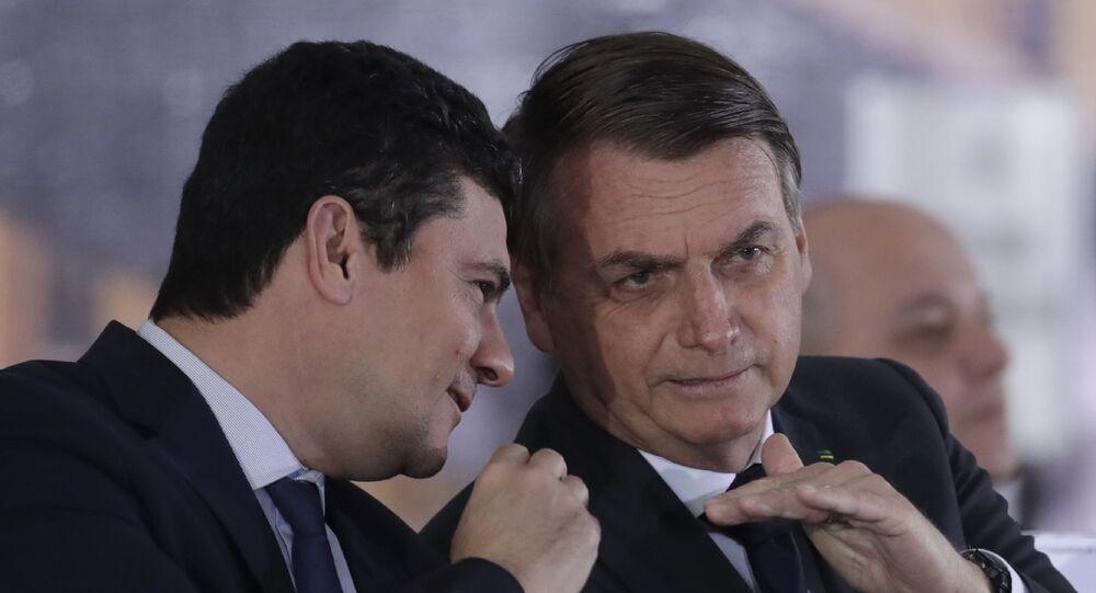 O ministro da Justiça e da Segurança Pública, Sergio Moro, e o presidente Jair Bolsonaro durante evento em Brasília em 9 de agosto de 2019.