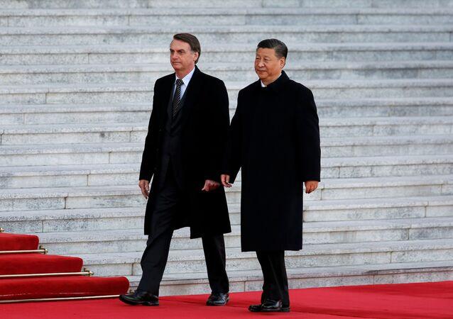 Jair Bolsonaro, presidente do Brasil, é recebido pelo líder chinês, Xi Jinping, em Pequim