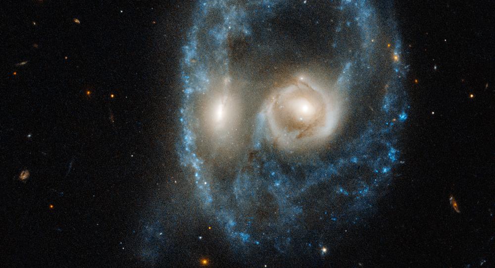 Imagem da colisão entre duas galáxias tirada pelo telescópio Hubble da NASA