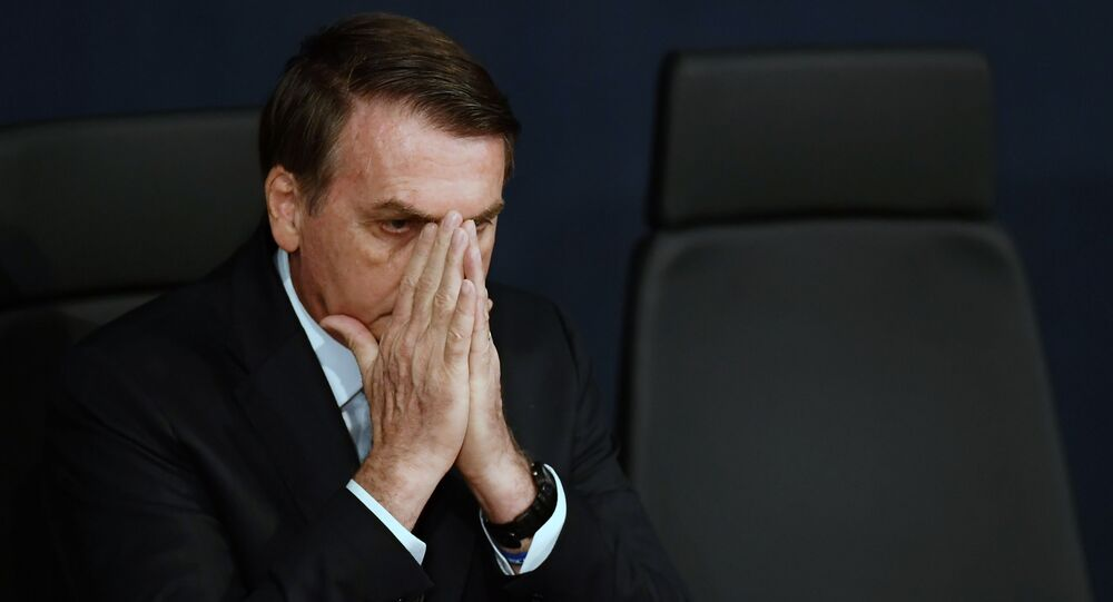 Presidente do Brasil, Jair Bolsonaro, na tomada de posse do novo procurador-geral do Brasil, Augusto Aras, Brasília, 2 de outubro de 2019.