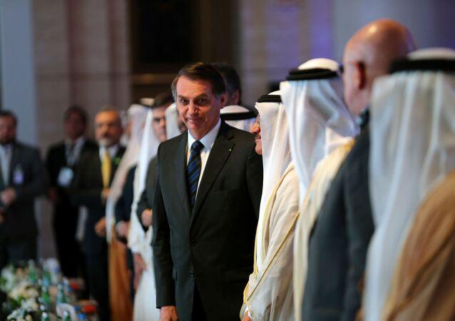 O presidente brasileiro, Jair Bolsonaro, no Fórum de Negócios Emirados Árabes Unidos-Brasil, em Abu Dhabi, Emirados Árabes, em 27 de outubro de 2019