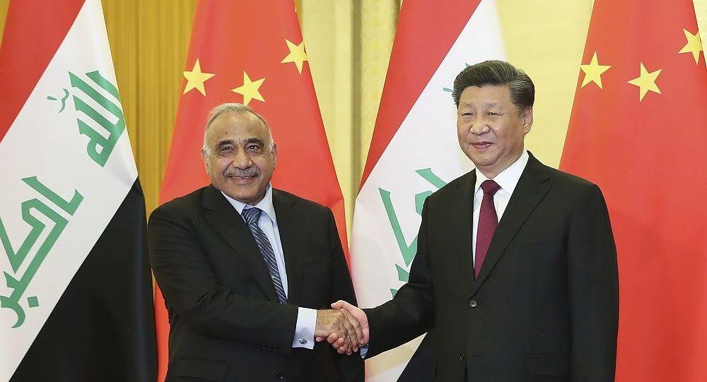 Líder chinês Xi Jinping (à direita) e premiê iraquiano Adel Abdul Mahdi (à esquerda) em Pequim