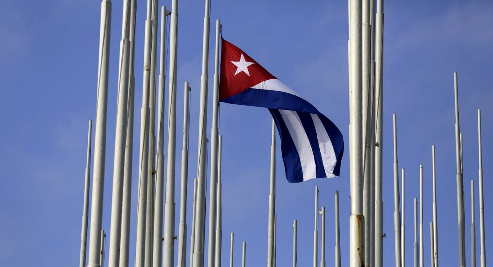 The Cuban flag flies in front of the U.S. Interests Section (background), in Havana May 22, 2015