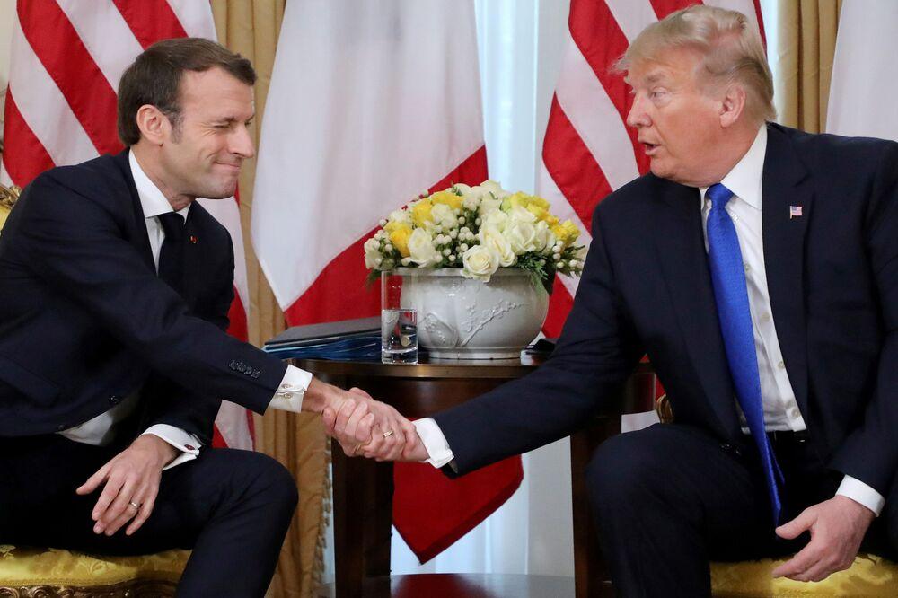 Presidentes Emanuel Macron e Donald Trump durante encontro em Londres.