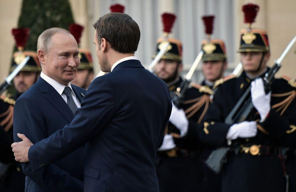 Presidente da Rússia, Vladimir Putin, e seu homólogo francês, Emmanuel Macron