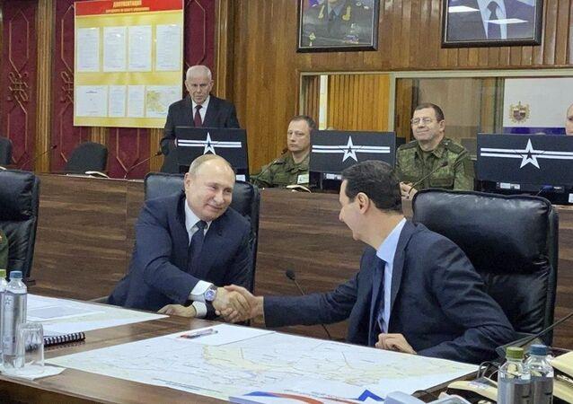 Presidente da Rússia, Vladimir Putin, e presidente da Síria, Bashar Assad, durante o encontro em Damasco, 7 de janeiro de 2020