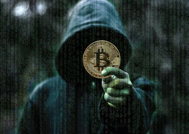 Hacker com bitcoin (imagem ilustrativa)