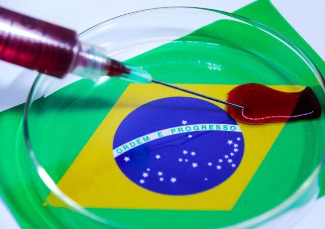 Imagem ilustrativa da COVID-19, doença causada pelo novo coronavírus, com a bandeira do Brasil