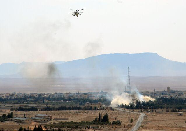Helicóptero russo Ka-52 em operação na Síria