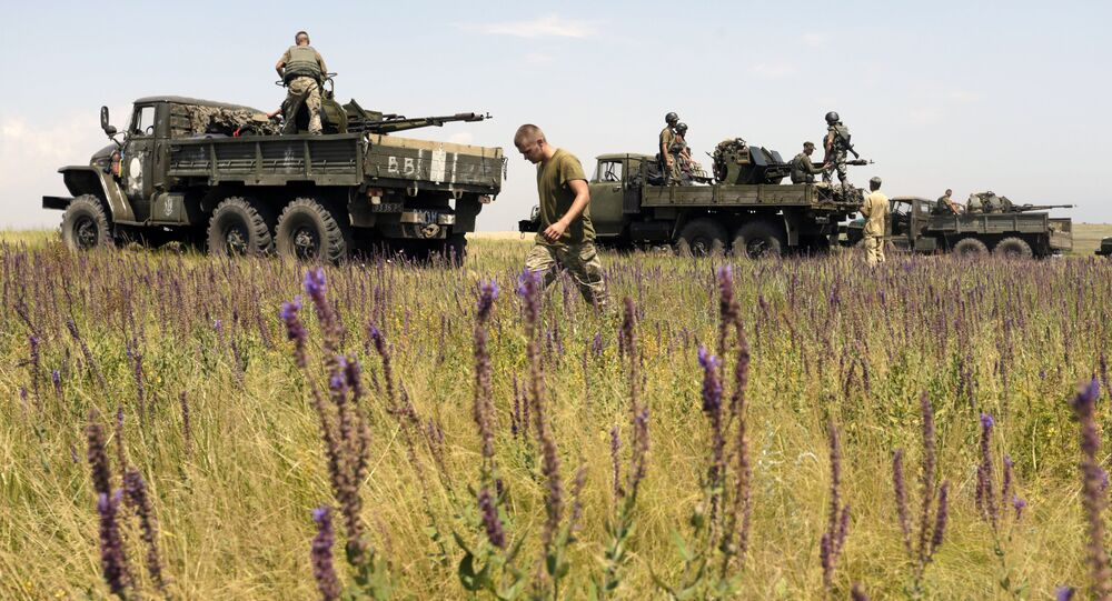 Anti-aircraft gunners of Ukrainian forces take part in exercises not far from southeastern city of Mariupol, Donetsk region on July 7, 2015.