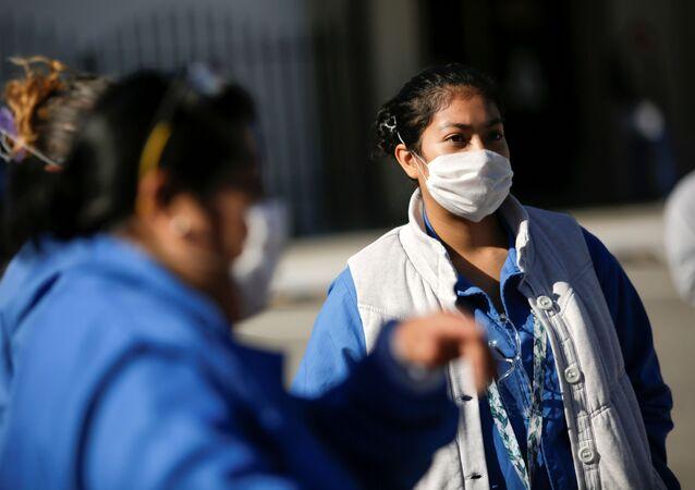 Agentes de saúde em Ciudad Juárez, México, em 16 de abril de 2020