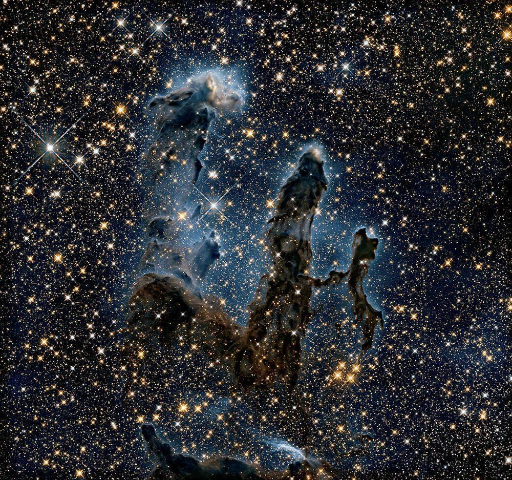 Aglomerados Pilares da Criação na nebulosa da Águia são fotografados pelo telescópio Hubble