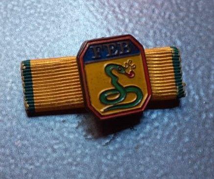 Distintivo Cobra Fumando, que adornava o uniforme do pracinha Oswaldo Lellis, quando ele partiu para a Sicília