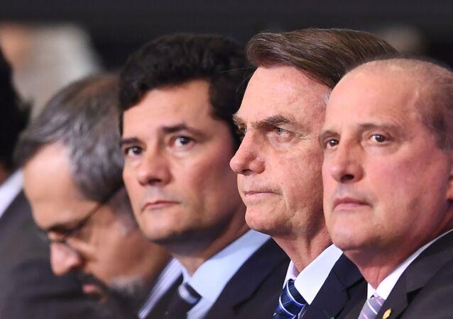 O presidente Jair Bolsonaro, o ex-ministro da Justiça e Segurança Pública, Sérgio Moro e o ministro da Cidadania, Onyx Lorenzoni, 22 de agosto de 2019 (foto de arquivo)