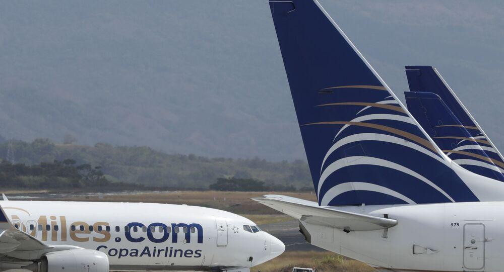 Aviões da Copa Airlines estacionados na pista do aeroporto internacional de Tocumen, na Cidade do Panamá, 22 de março de 2020