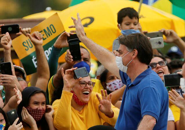 O presidente Jair Bolsonaro em protesto realizado em Brasília contra o STF e a Câmara dos Deputados. Foto de 17 maio de 2020.