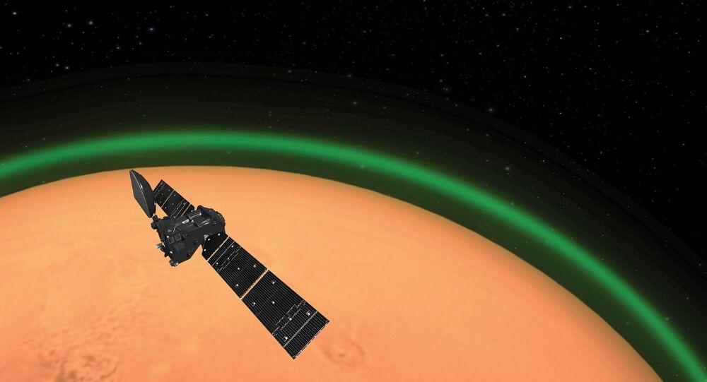 Representação artística exibe brilho verde na atmosfera de Marte