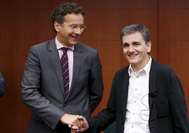 Presidente do Eurogrupo Jeroen Dijsselbloem e Ministro das Finanças da Grécia Euclid Tsakalotos.