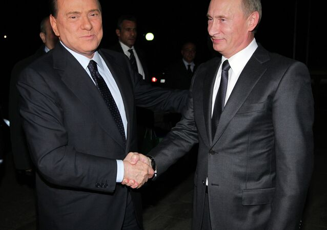 Presidente da Rússia Vladimir Putin e ex-premiê da Itália Silvio Berlusconi