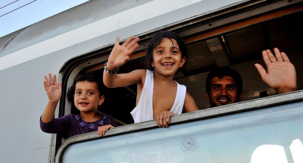 Trem com refugiados partindo da cidade croata de Ilača, perto da fronteira com a Sérvia, em direção a Zagreb, capital da Croácia