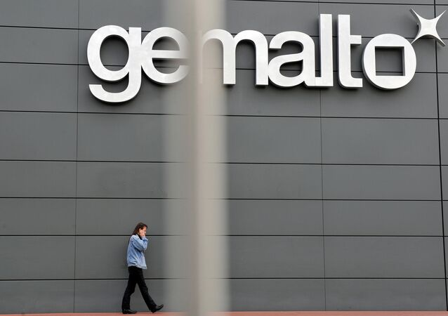 An employee walks outside the Gemalto building, the world's leading digital security firm.
