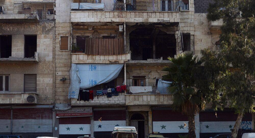 Um edifício residencial destruido na cidade síria de Aleppo