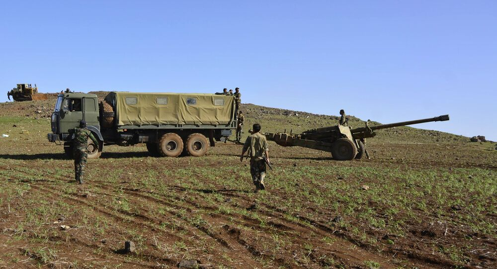 Soldados do Exército Sírio no monte Fátima, na província de Deraa, em março de 2015