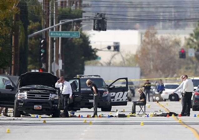 Police and Sheriff's Office Crime Scene Iinvestigators examine evidence at the scene of the investigation around an SUV where two suspects were shot by police following a mass shooting in San Bernardino, California December 3, 2015.