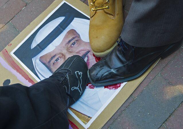 Protesters step on a photo of Saudi King Salman on September 4, 2015.