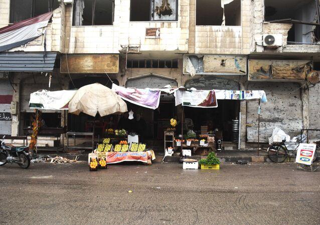 Loja de frutas e legumes em uma das ruas de Homs, na Síria, em 26 de janeiro de 2016